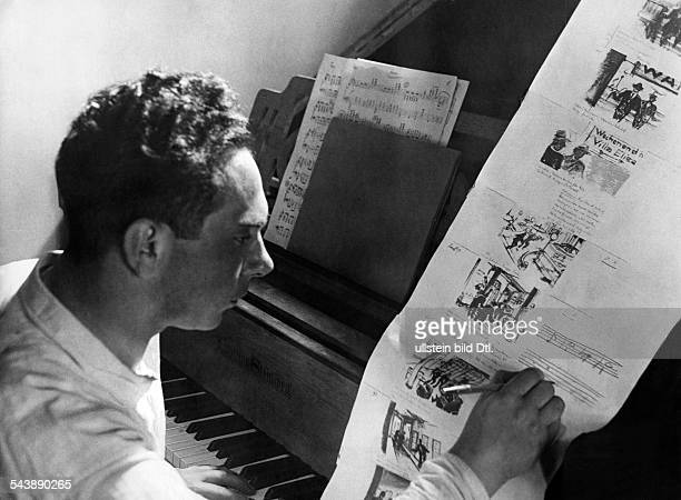 Preparations for filming Creation of a storyboard A composer writing the music of the scene in a script ca 1932 Photographer Weltrundschau Erich...