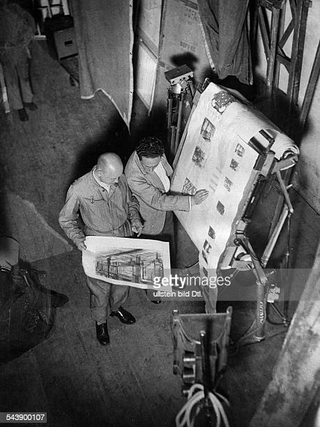 Preparations for shooting the director discusses by the storyboard the structure of the film set for a scene with a set designer undated about 1932...
