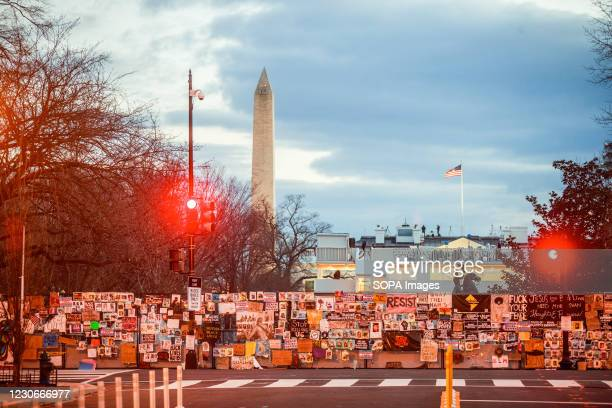 Preparations for the inauguration of United States president elect Joe Biden are seen near the White House beyond a wall of Black Lives Matter art...