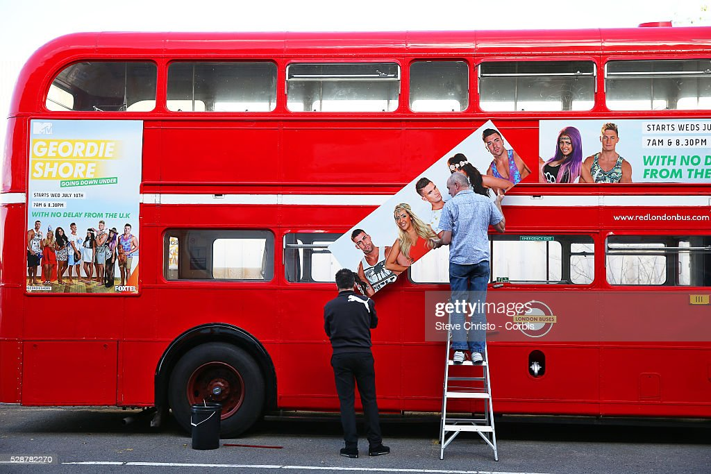 Preparations on an old red London bus for the launch of Geordie