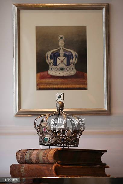 A preparatory model of the Imperial State Crown of India worn in 1911 by King George V stands next to original ledgers dating from 1735 in Garrard's...
