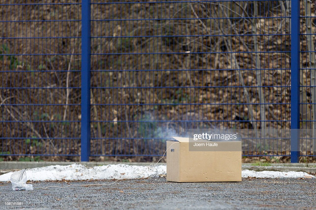 A prepared Box explodes during a illegal fireworks presentation by the Saxony state police to the media on December 27, 2012 in Dresden, Germany. The legalized sale of fireworks to welcome in the New Year begins nationwide in Germany on December 28 and police are warning of the danger of certain types of fireworks imported illegally from countries like Poland and the Czech Republic.