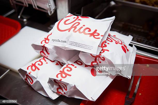 Prepared chicken sandwiches sit in a piie before being served to guests during an event ahead of the grand opening for a ChickfilA restaurant in New...