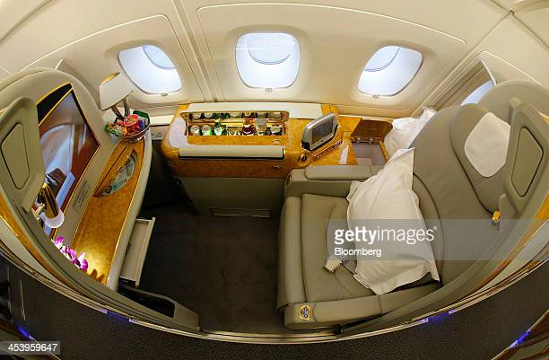 A prepared first class seat sits ready for a passenger onboard an Airbus A380800 aircraft operated by Emirates as the plane waits to depart from...