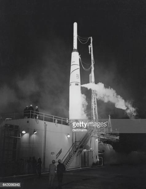 Prepared For Launching Cape Canaveral Florida The Lunar Probe missile 'Pioneer' stands in front of its gantry as missilers make the thorable ready...