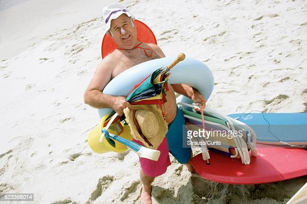 prepared for the beach - fat man on beach stock photos and pictures
