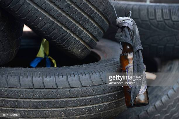 A prepared molotovcocktail is pictured behind a tire stack at a barricade at Hrushevskoho Street on February 6 2014 in Kiev Ukraine German Foreign...