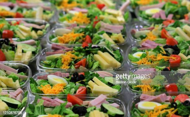 Prepared salads wait to be packed to go at Brandeis University in Waltham, MA on April 16, 2020. Food service provider Sodexo is working with its...