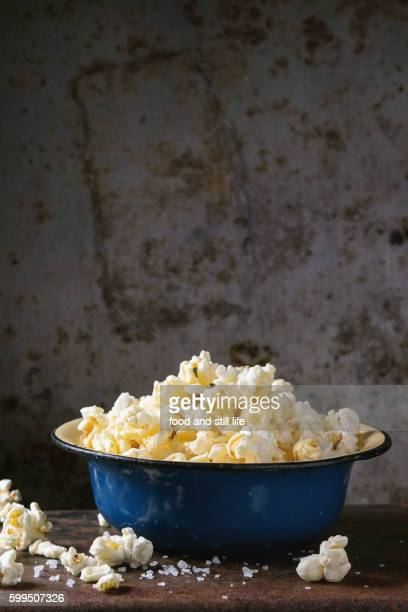 prepared salted popcorn - blue film video stock pictures, royalty-free photos & images