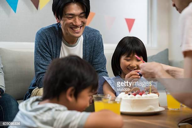 Preparing a birthday cake at a family birthday party
