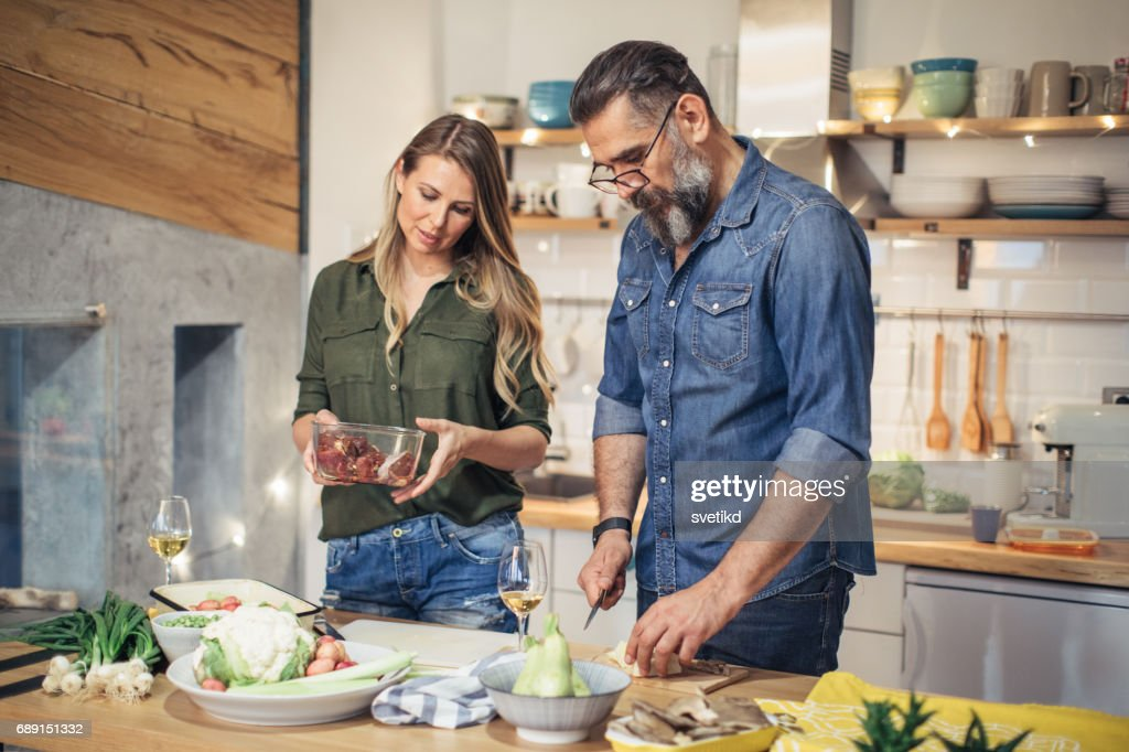 Preparing a delicious meal at home : Stock Photo