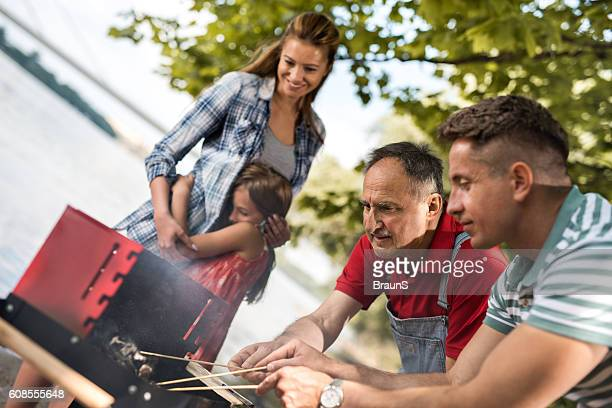 preparing a fire for barbecue! - mother and daughter smoking stock photos and pictures