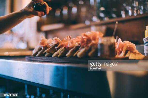 preparing a sandwich platter - mmeemil stock photos and pictures
