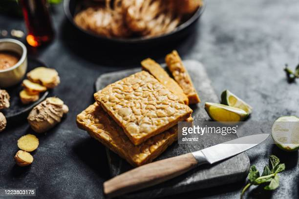 preparing a vegan dish with tempeh - meat substitute stock pictures, royalty-free photos & images