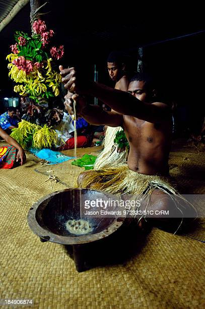 Preparing and squeezing kava to drink at a traditional ceremony Wiwi Village Taveuni Island Pacific Ocean Fiji Islands