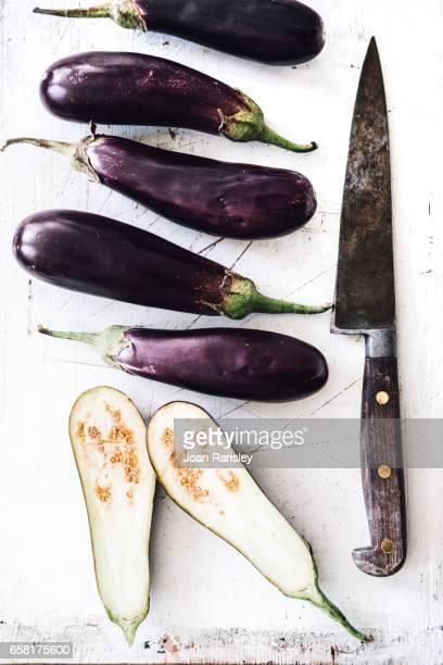 preparing aubergine - eggplant stock photos and pictures