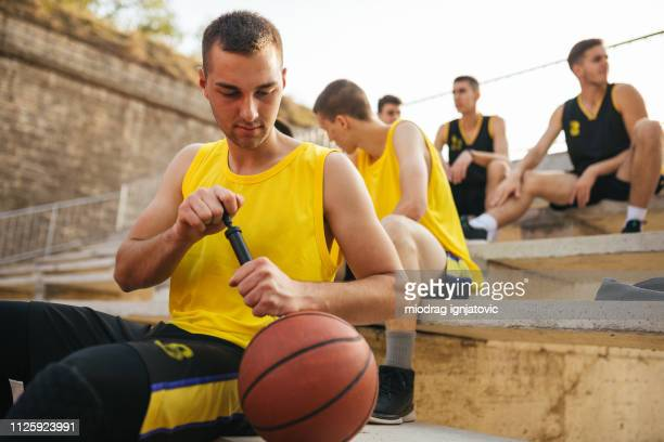 preparing ball for basketball game - inflating stock pictures, royalty-free photos & images