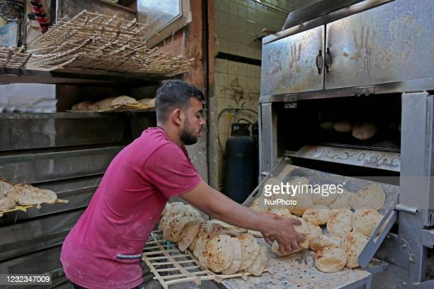 Preparing bread before breakfast during the holy month of Ramadan, on April 16 Cairo, Egypt