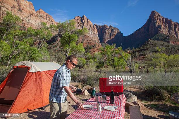 Preparing campsite table, Zion, Utah
