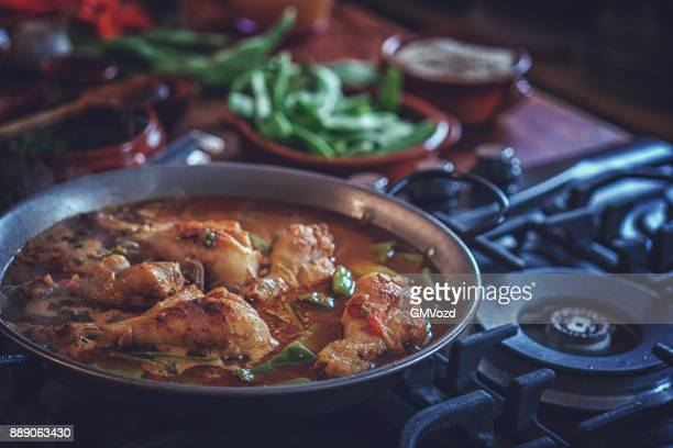 Preparing Chicken Paella with Green Beans, Peas and Paprika