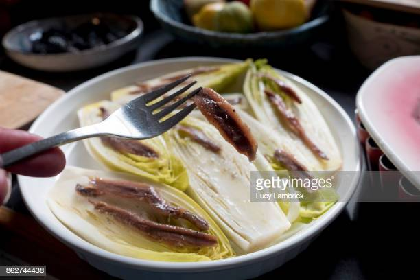 Preparing chicory with anchovies