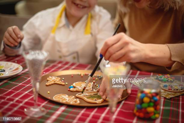 preparing cookies for christmas - colouring stock pictures, royalty-free photos & images