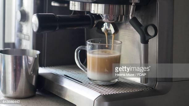 Preparing cup of espresso coffee