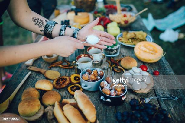 preparing dessert on the picnic - tapas stock photos and pictures
