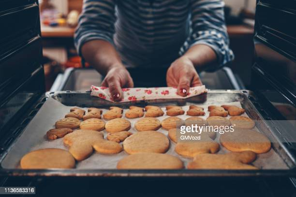 preparing easter cookies for easter time - easter cake stock pictures, royalty-free photos & images