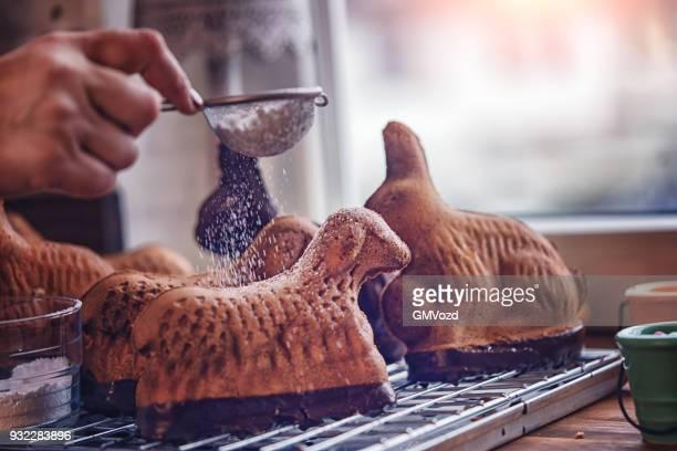 preparing easter lamb cake in domestic kitchen - agnellino foto e immagini stock