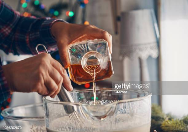 preparing eggnog for christmas - eggnog stock photos and pictures