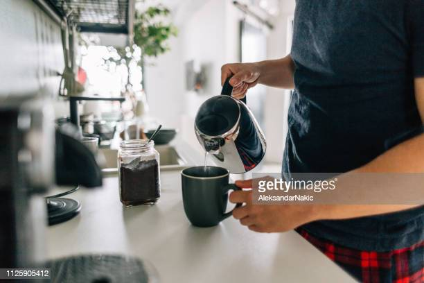 preparing first cup of coffee in the morning - morning stock pictures, royalty-free photos & images