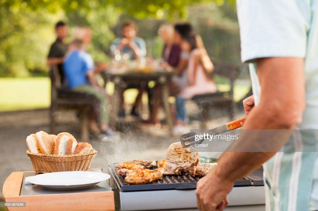 Preparing food at picnic : Stock Photo
