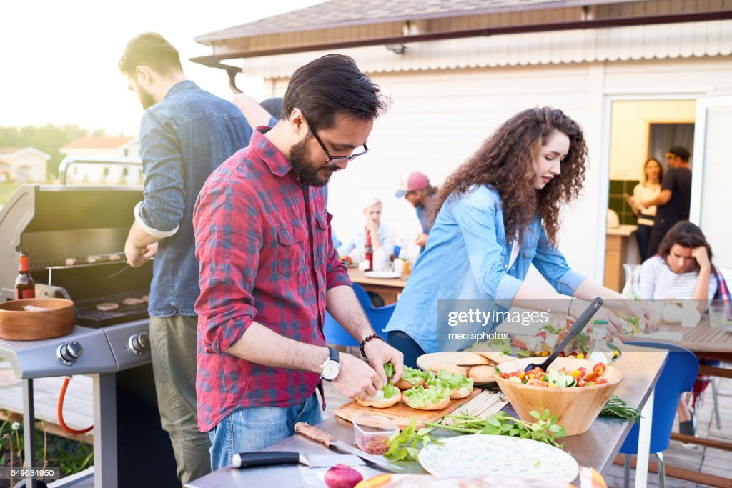 Preparing food for dinner party : Stock Photo