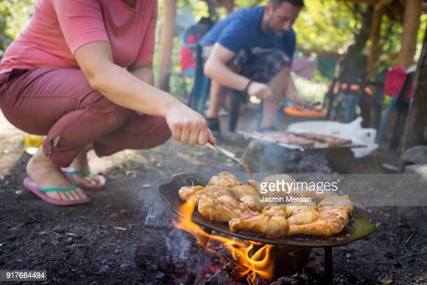 Preparing food for family at picnic in nature