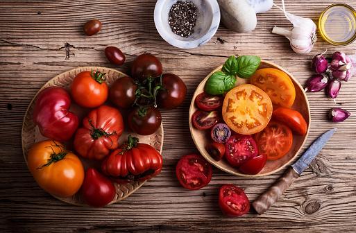 Preparing food. Fresh homegrown colofrul tomatoes - gettyimageskorea