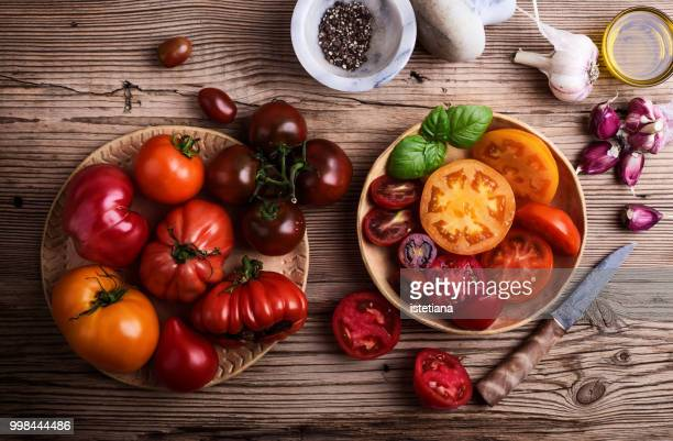 preparing food. fresh homegrown colofrul tomatoes - fall harvest stock pictures, royalty-free photos & images