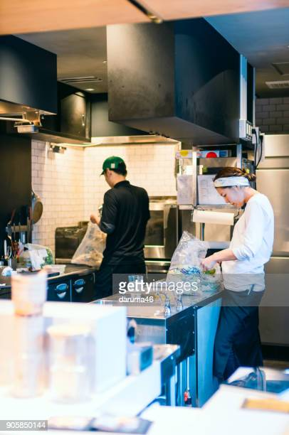 Preparing Food in Kitchen at Coffee Shop