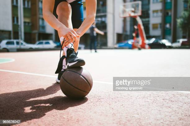 preparing for a game - basketball shoe stock photos and pictures