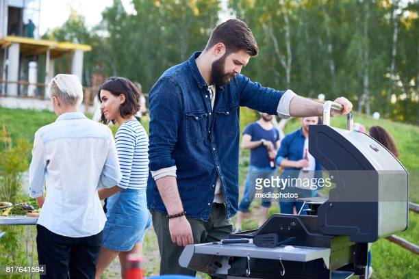 preparing for barbecue party - open grave stock photos and pictures