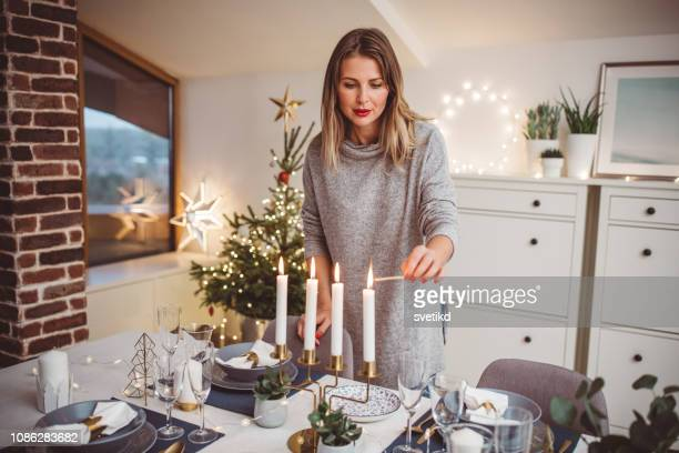 preparing for christmas dinner - candle stock pictures, royalty-free photos & images