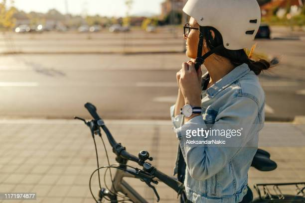 preparing for the bike ride - sports helmet stock pictures, royalty-free photos & images