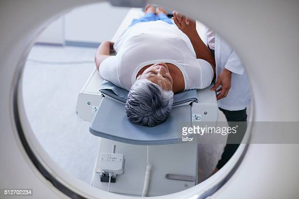 preparing for the scan - cancer stock photos and pictures