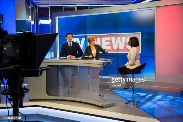 preparing for the tv news interview - press conference stock pictures, royalty-free photos & images