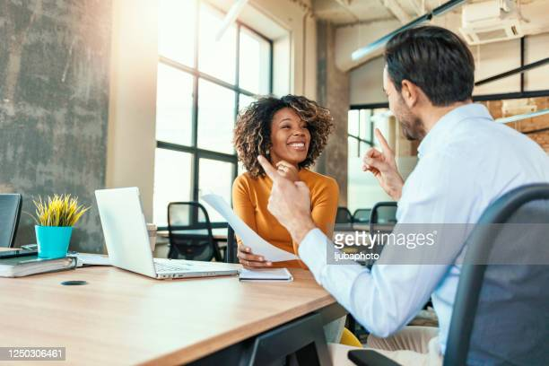 preparing for their client pitch - risk stock pictures, royalty-free photos & images