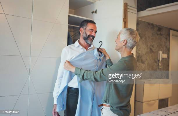 preparing for work - getting dressed stock pictures, royalty-free photos & images