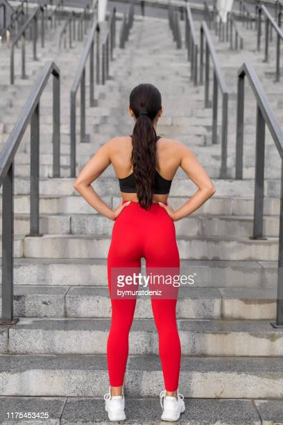 preparing for workout - beautiful female bottoms stock pictures, royalty-free photos & images