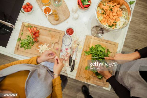 preparing fresh ingredients - femalefocuscollection stock pictures, royalty-free photos & images