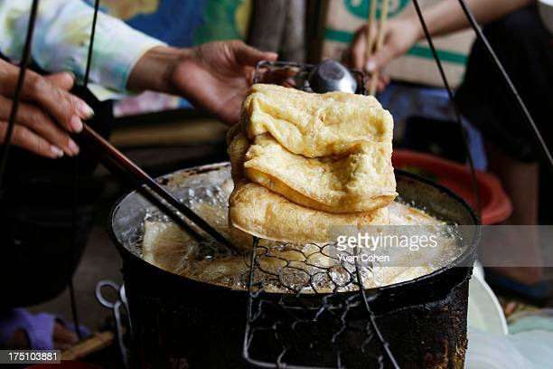 Preparing fried tofu at a street food stall in Hanoi Hanoi is Vietnam's administrative capital and the seat of the nation's ruling communist party...