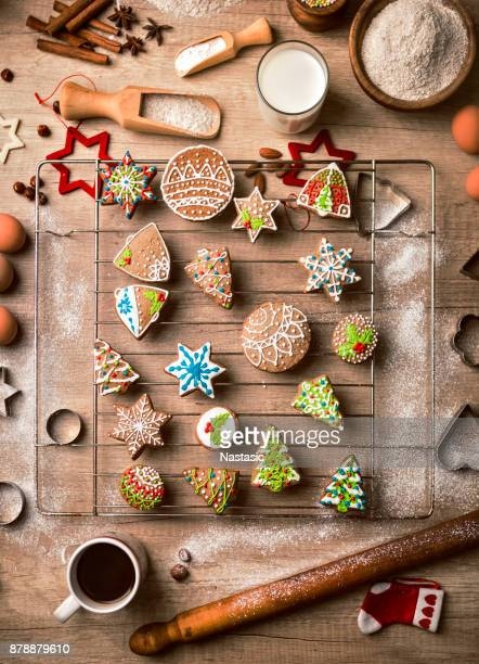 preparing gingerbread christmas cookies in kitchen - christmas cookies stock pictures, royalty-free photos & images